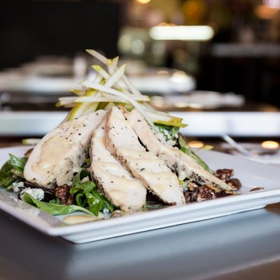 Wild Pear Salad with candied pecans, fresh pears and blue cheese on a bed of organic mixed greens with a housemade roasted pear vinaigrette.