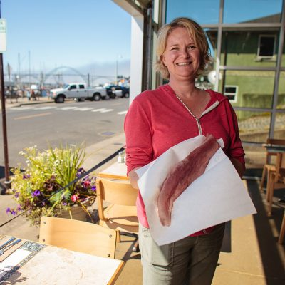 Local Ocean chef, Laura Anderson displays a tuna filet from her restaurant located across the street from the commercial fishing fleet in Newport where her company purchases fish from 60 boats year round.