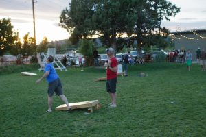 Customers at Crux Fermentation Project in Bend play cornhole and other recreational games. Photo by Rob Kerr