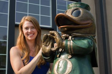 Allison Brown with Oregon Duck Bronze Sculpture