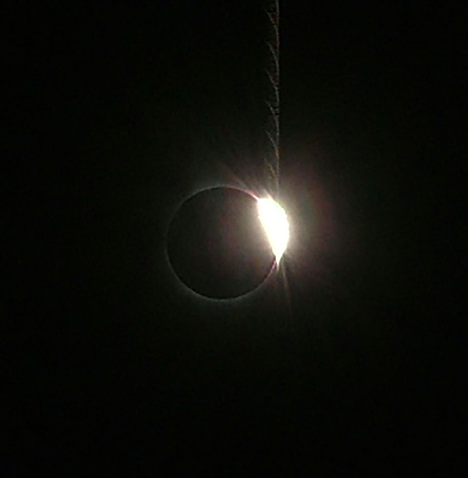 The end of totality. However, before more than a sliver of the sun had a chance to pop into view, I snapped a picture of what is called the Diamond Ring.