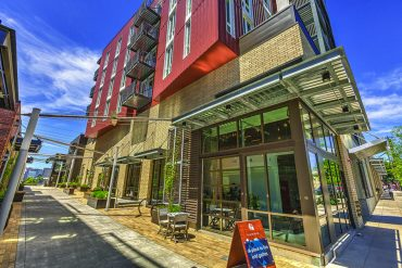 The Goat Blocks in Southeast Portland feature four apartment buildings with community spaces, rooftop decks and an array of businesses on the ground floor.